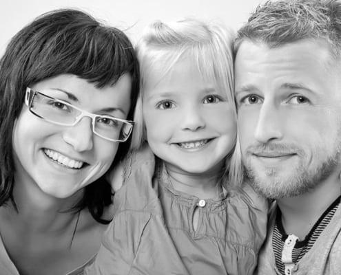 Familienfotografie - Porträt einer Familie mit Kind